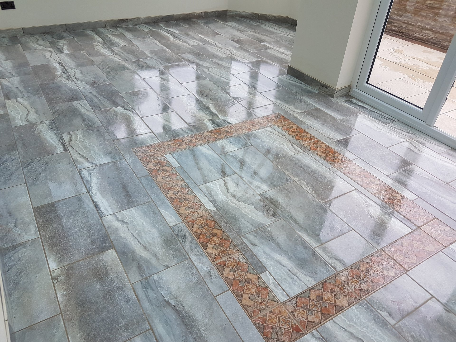 Graham wood ceramics porcelain flooring in guisborough create that striking design with a brick bond layout coloured grouting and central feature dailygadgetfo Gallery