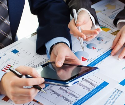 Professionals analyzing the financial reports for taxation