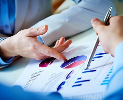 Experts analyzing business statements for taxation services