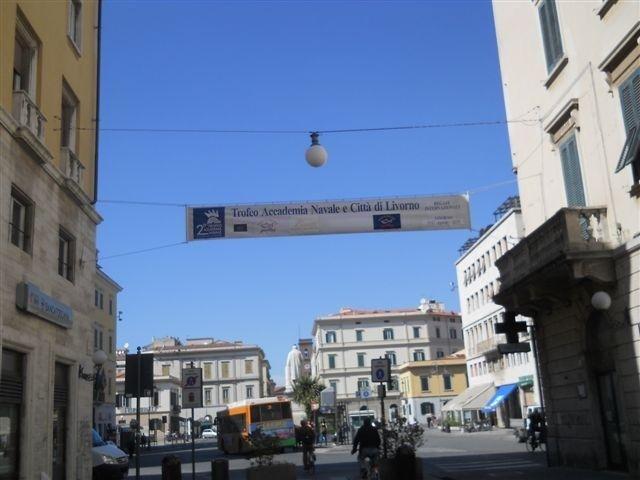 un manifesto con scritto Trofeo Accademia Navale e Città di Livorno