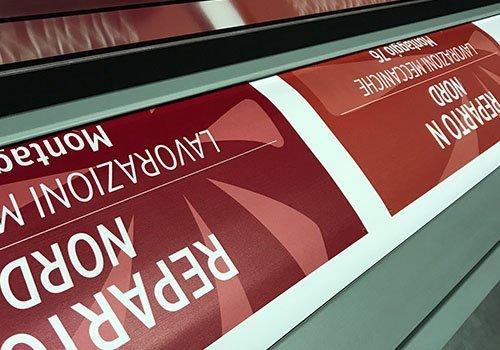 un poster con le scritte Reparto Nord