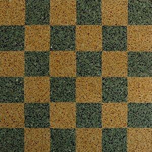 un pavimento con piastrelle di colore giallo e verde