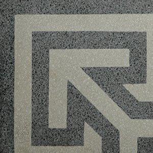 un pavimento con i disegni dell'edera e color rosso