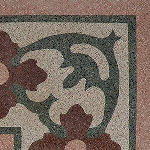 un pavimento con disegni di fiori rossi e verdi