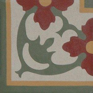un pavimento con i disegni color verde e fiori rossi