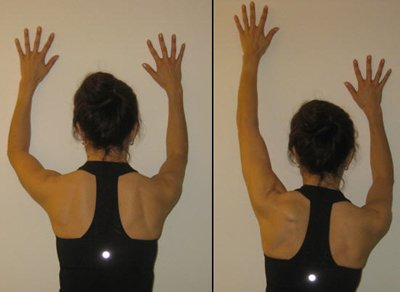Figure 4: Wall plank with arm slide: start (left); finish (right). The athlete maintains stability of her right scapula as the left arm reaches up the wall. Her deep neck flexors are activated and she maintains this long spine position throughout the pattern.