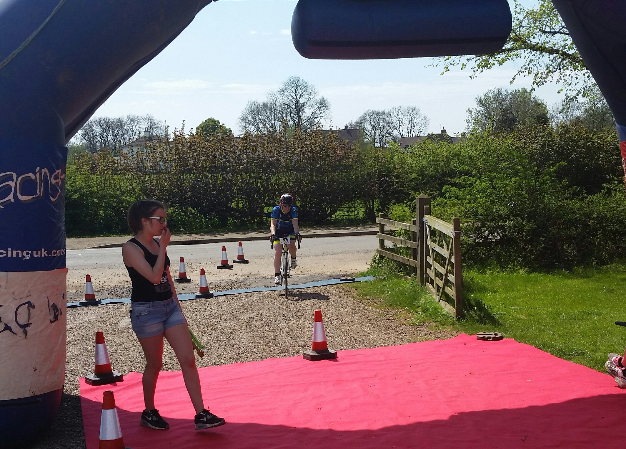 Dina crossing the finish line