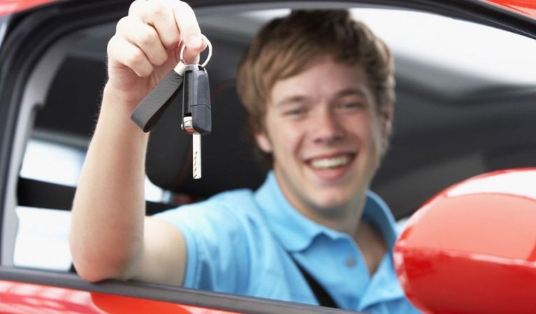 driving force training services man on car with key