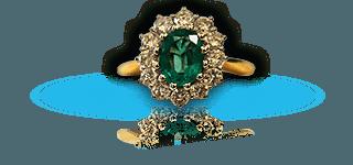Anello di donna con smeraldo centrale circondata di diamanti
