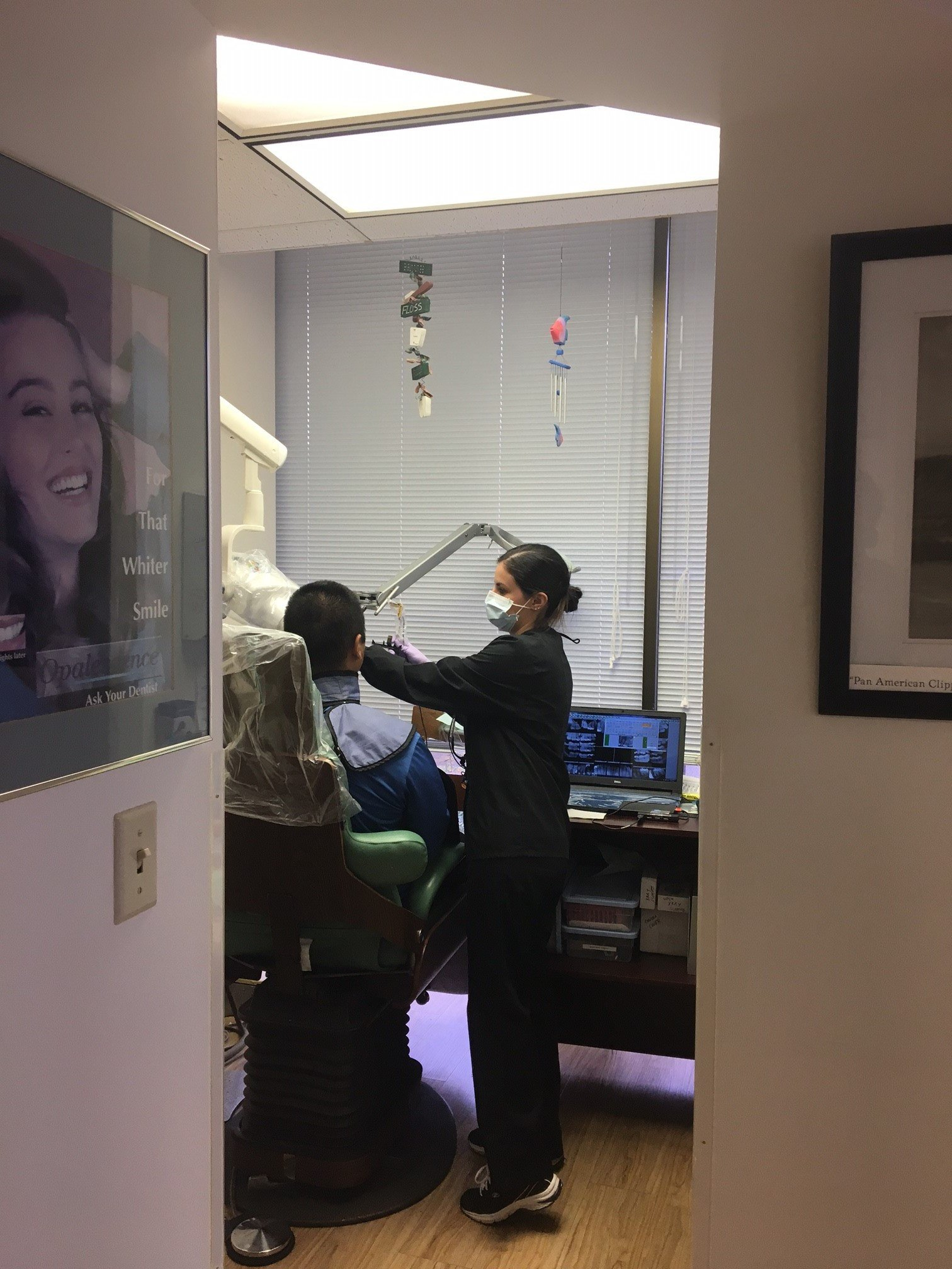 Customer receiving checkup services from a practiced family dentist in Honolulu, HI