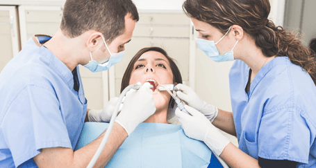 Dentists providing high quality dentist services to a patient in Honolulu, HI