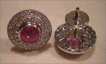 Natural pink Sapphire earrings with diamonds in platinum setting