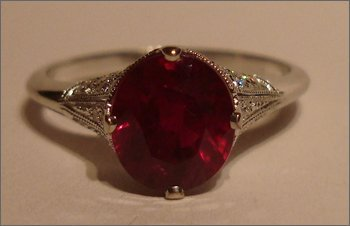 Red ruby ring with diamonds in platinum setting