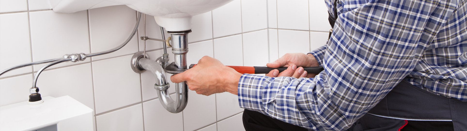 a plumber fixing a toilet