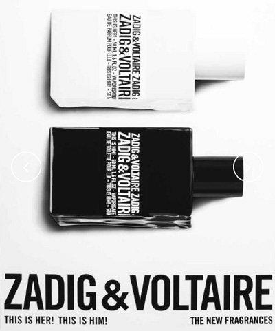 bottiglia di profumo nera e bianca