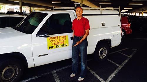 Employee by company truck in Honolulu, HI