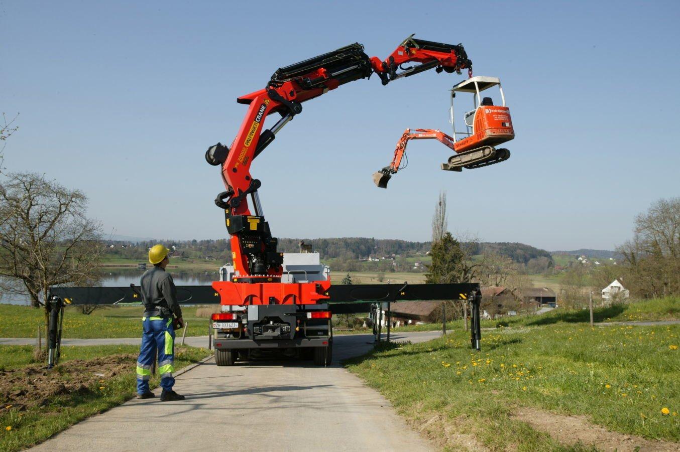Truck mounted Palfinger crane in service