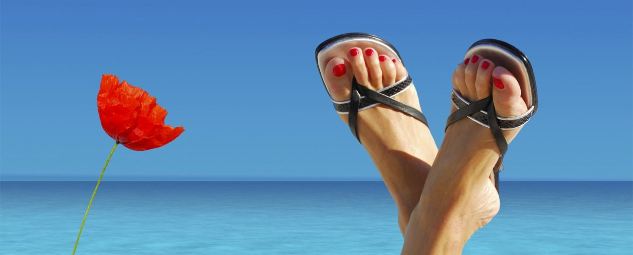 Women in flip flop and sitting by the beach