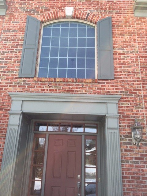 New door and window installed in a brick building in Cincinnati