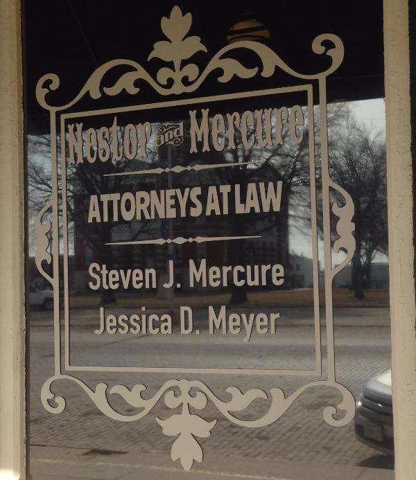 Law book in the hands of divorce attorney in Tecumseh, NE