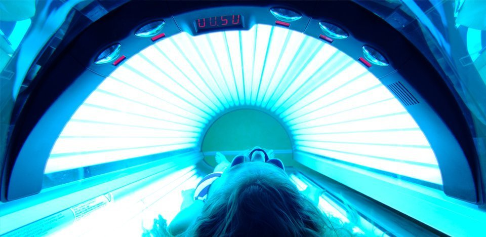 Woman tanning in a sunbed