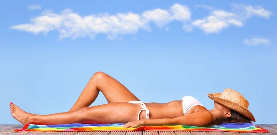 A woman sun tanning