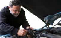Mechanic places new spares in a car
