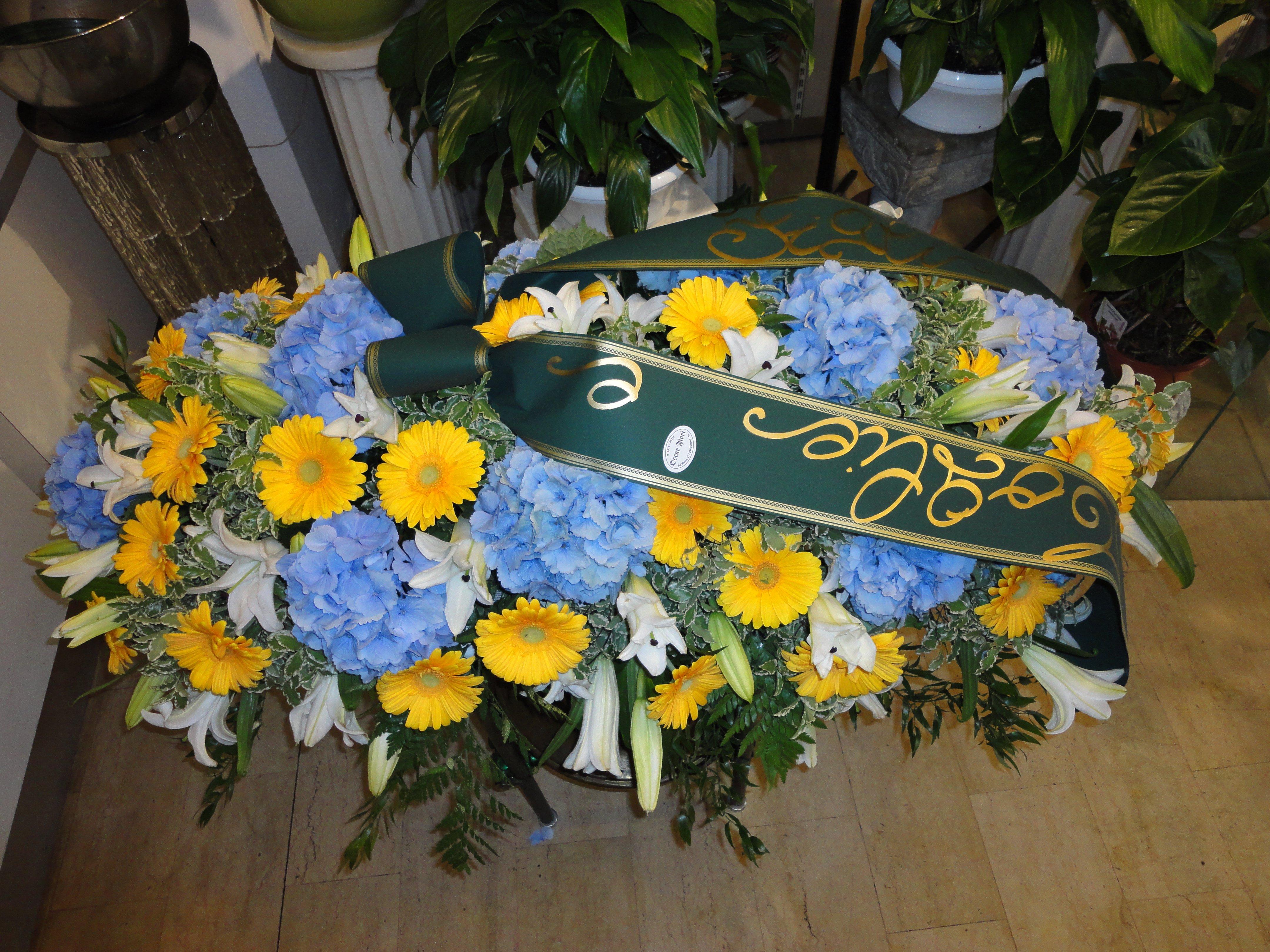mazzo funebre giallo e azzurro