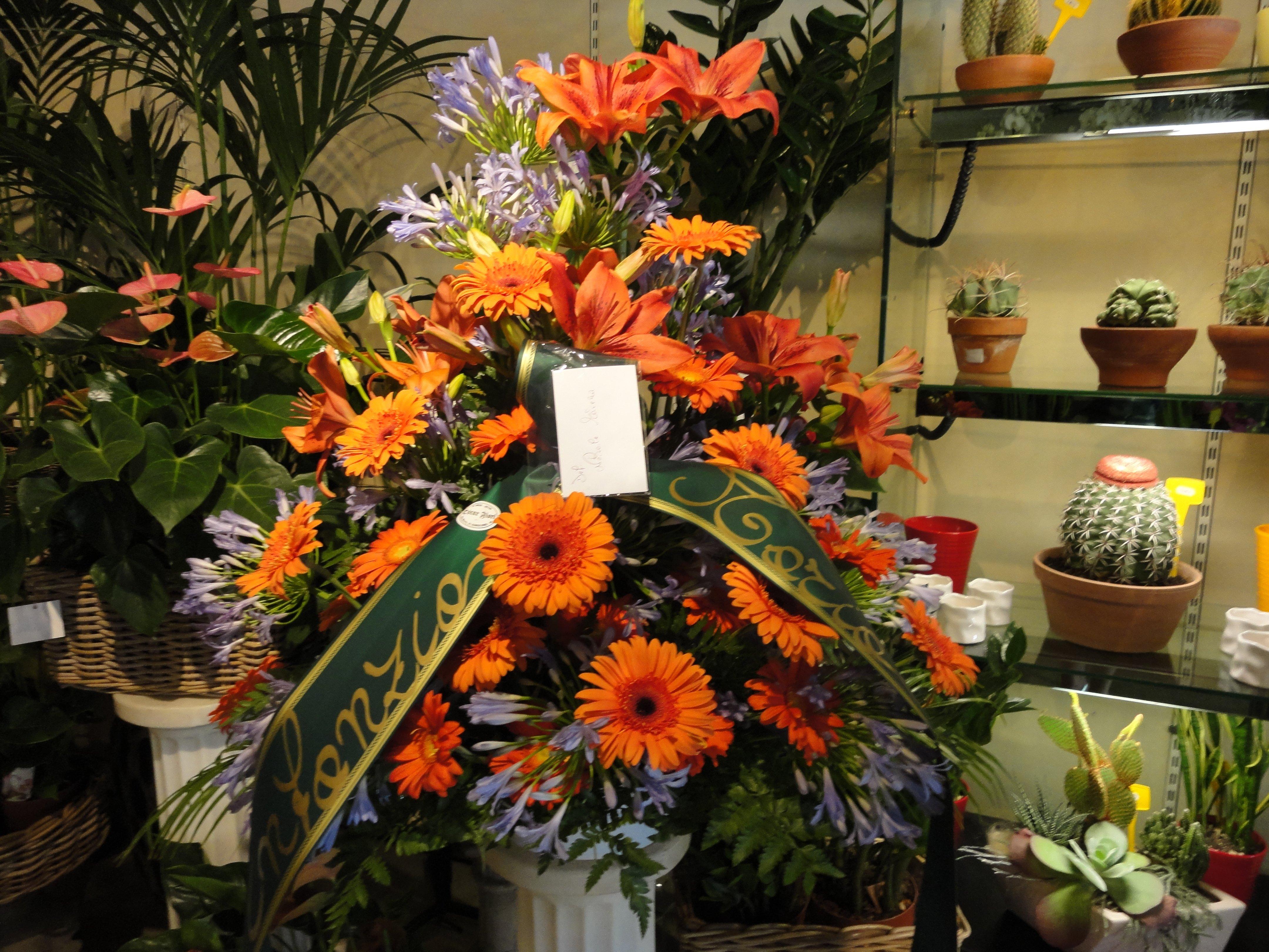 margherite arancioni per funerali