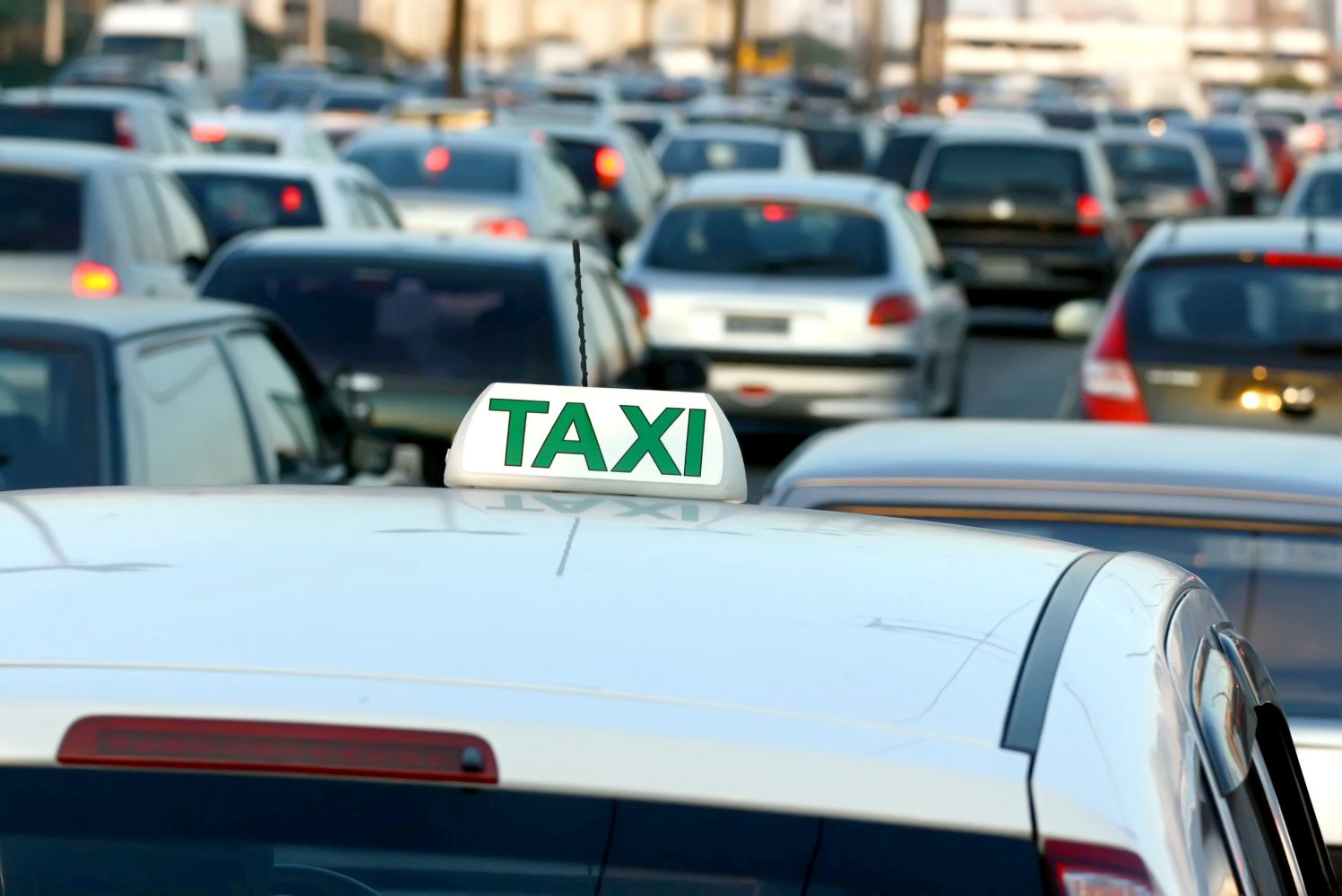 Cab with convenient airport taxi rate among cars in Monroe, NY