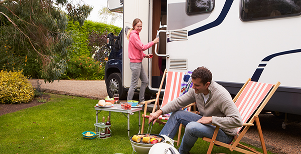 Couple enjoying barbeque on camping