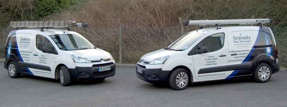 2 white vans