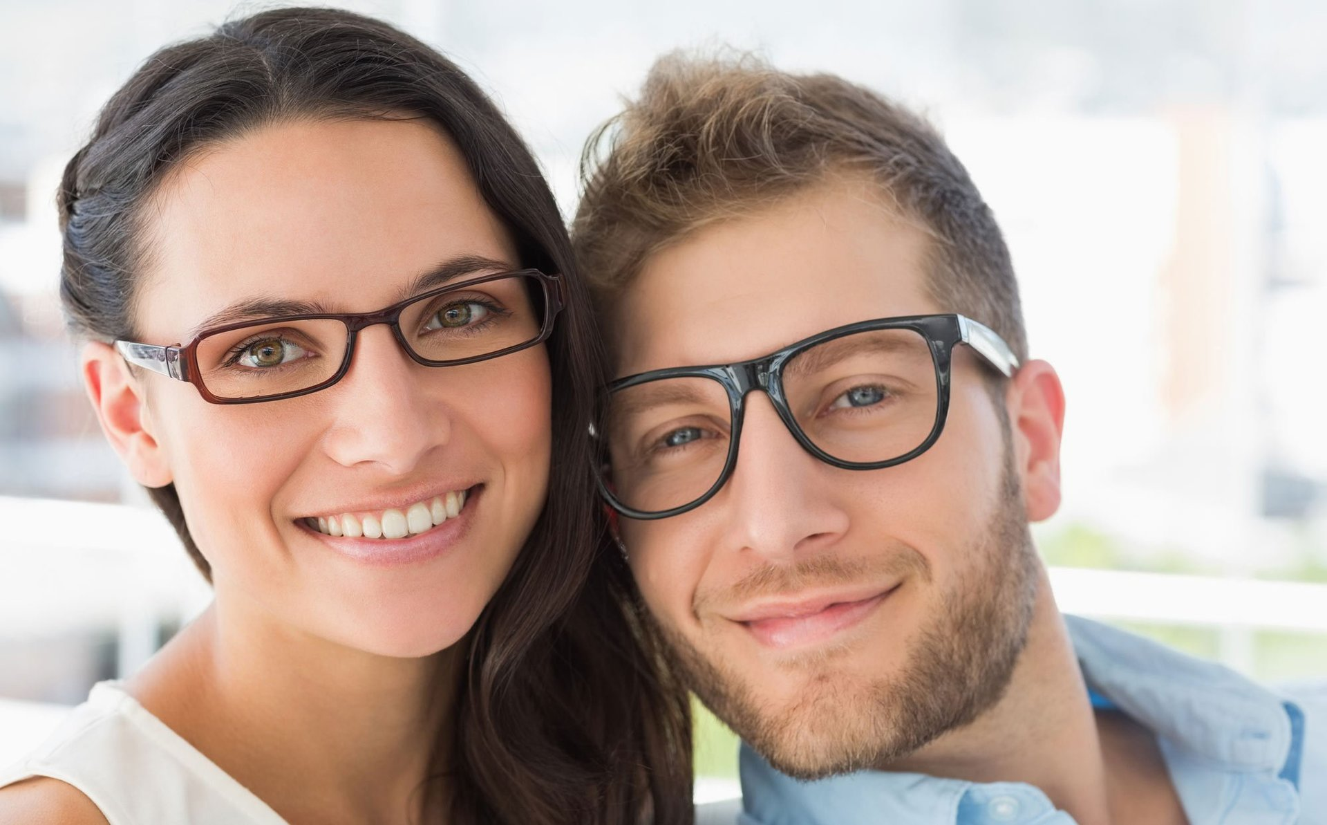 women and man faces with black glasses