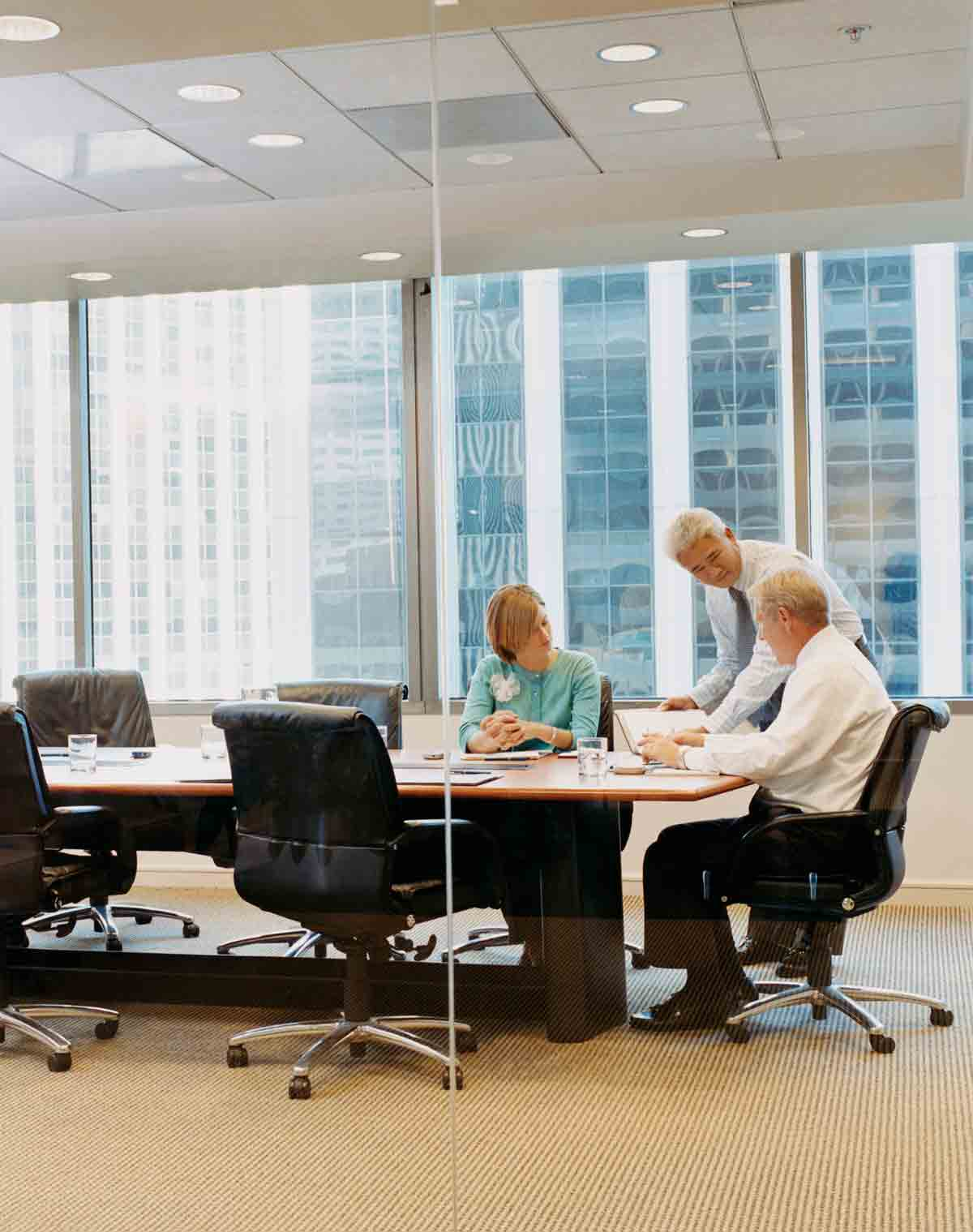 people sitting around a table in an office