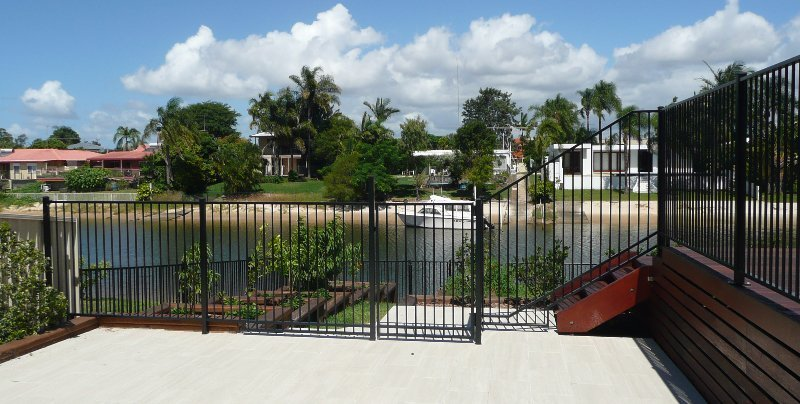 kelmac fencing and gates pool with a fence and lounge chairs