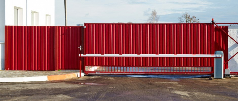 kelmac fencing and gates red sliding gate between two walls