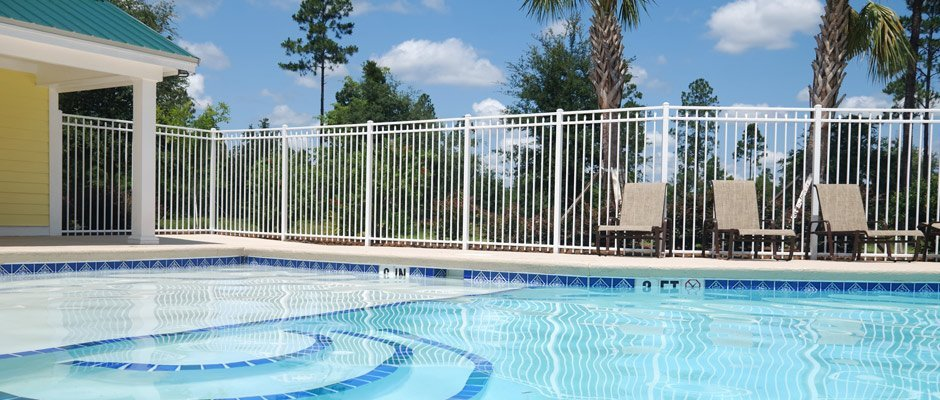 kelmac fencing and gates swiming pool with white iron fence