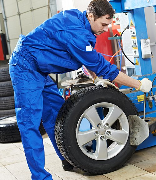 Professional repairing the car tyre