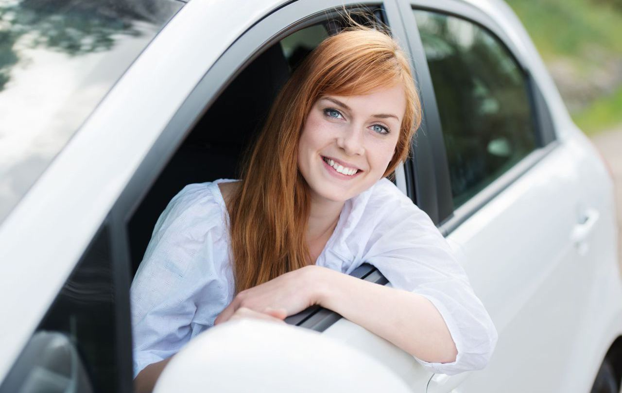 Satisfied lady with an auto insurance in Summerville, GA