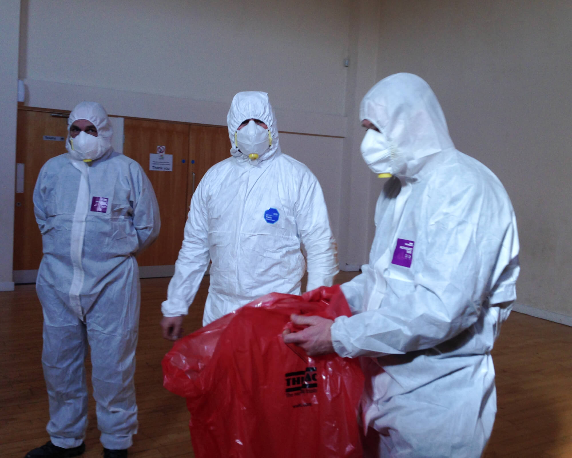 Training participants with white protection suits
