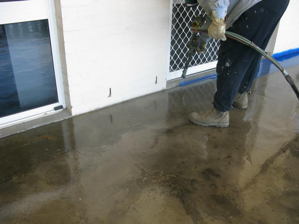 blakes waterproofing man working on the floor