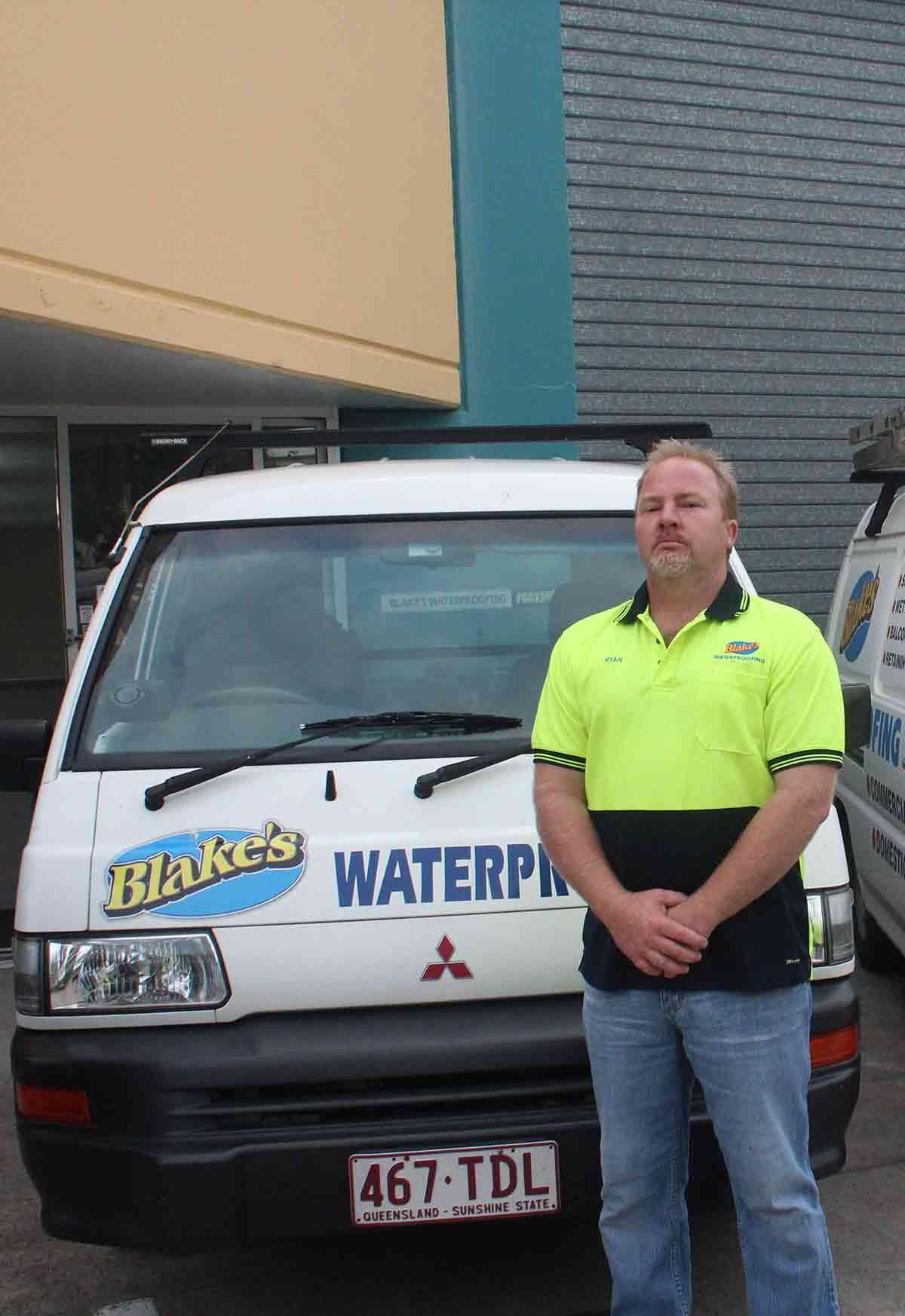 blakes waterproofing worker stand infront of van