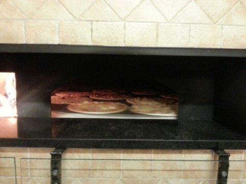 pizze cotte su forno a legna