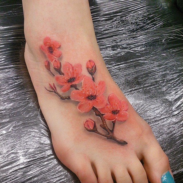 orange flowers tattoo