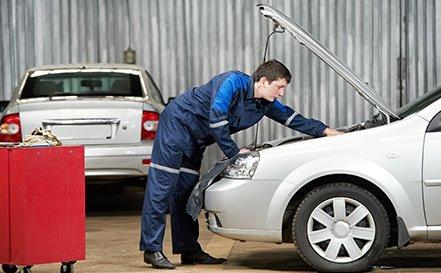 Checking car engine before maintenance