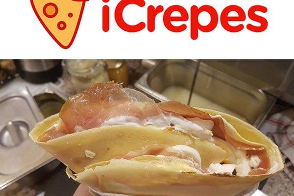 una crepes con prosciutto e formaggio arrotolata e sopra la scritta iCrepes