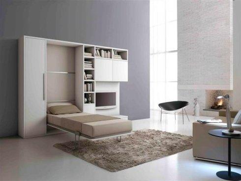 letti singoli, pareti attrezzate, librerie