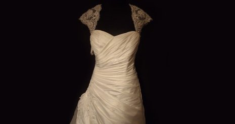 A wedding dress with lacey shoulders