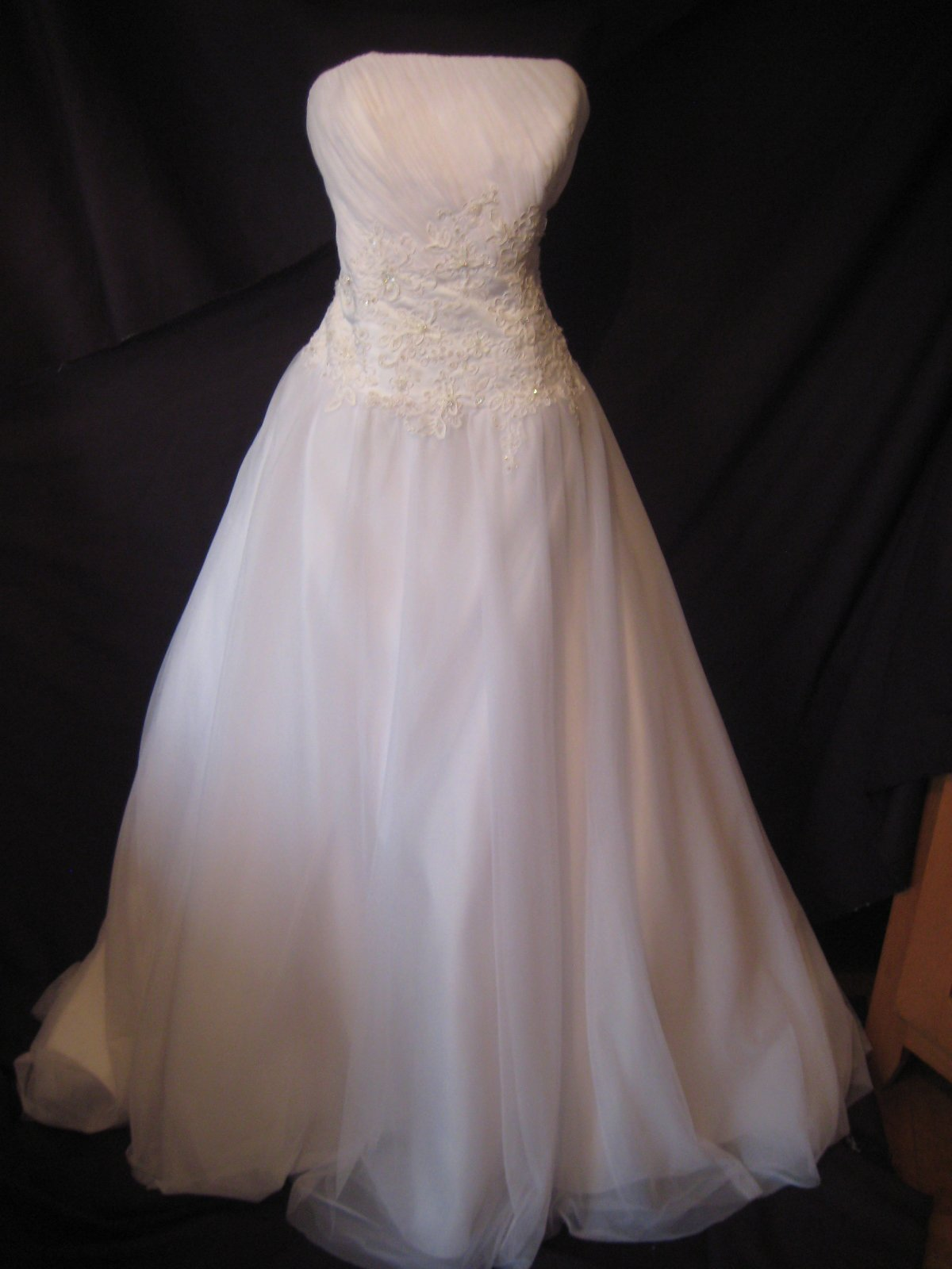 A long wedding dress with a decorated bust