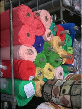 almacén tejidos stock